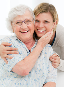 stock-photo-happy-affectionate-senior-woman-embrace-her-granddaughter-at-home-84856972