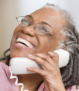stock-photo-close-up-of-senior-adult-woman-laughing-on-phone-220380241